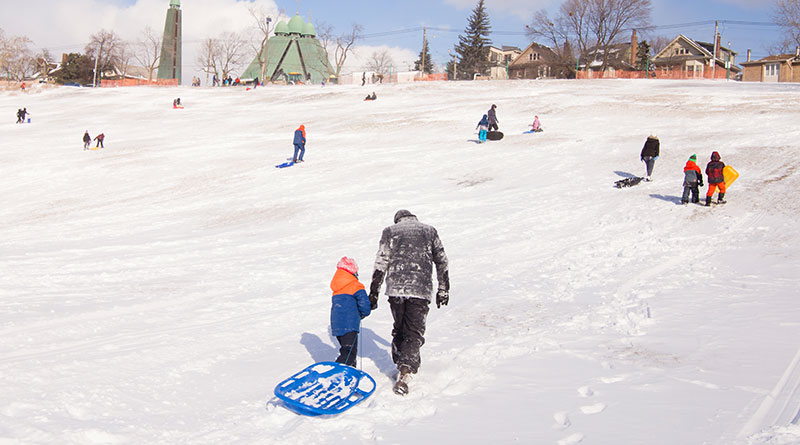 Kids and adults tobogganing despite tobogganing ban