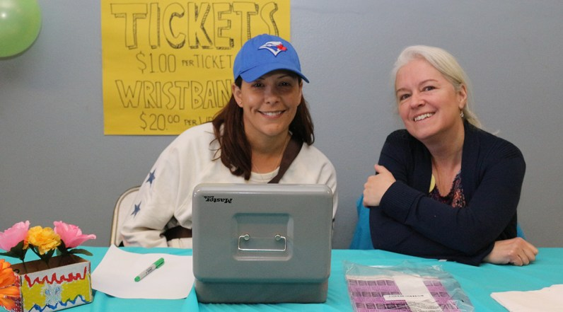 PARENT volunteers Theresa Shanahan, left, and Christine Piotrowski man the table for tickets at St. Monica's Spring Bazaar.