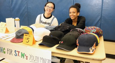 BRIDGET, left and Sabrina, raise awareness for St. Monica's Youth Ministry.