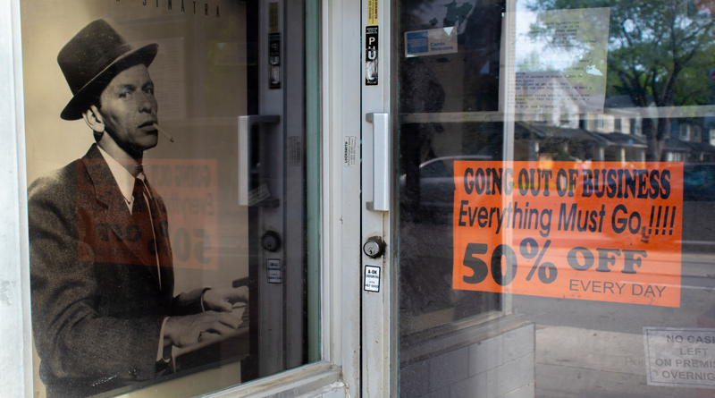 """This image shows a store with the sign that says """"Out of Business."""""""