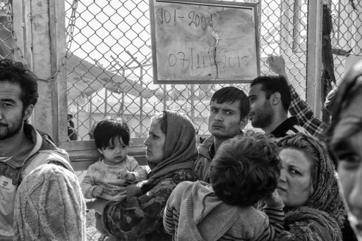 Men, women and children in line waiting to enter the registration center in Moria, Lesvos.