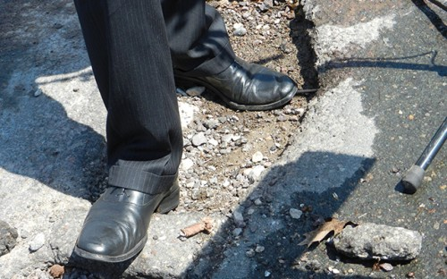 Cam Winton standing in a pothole. Monday, May 6, 2013