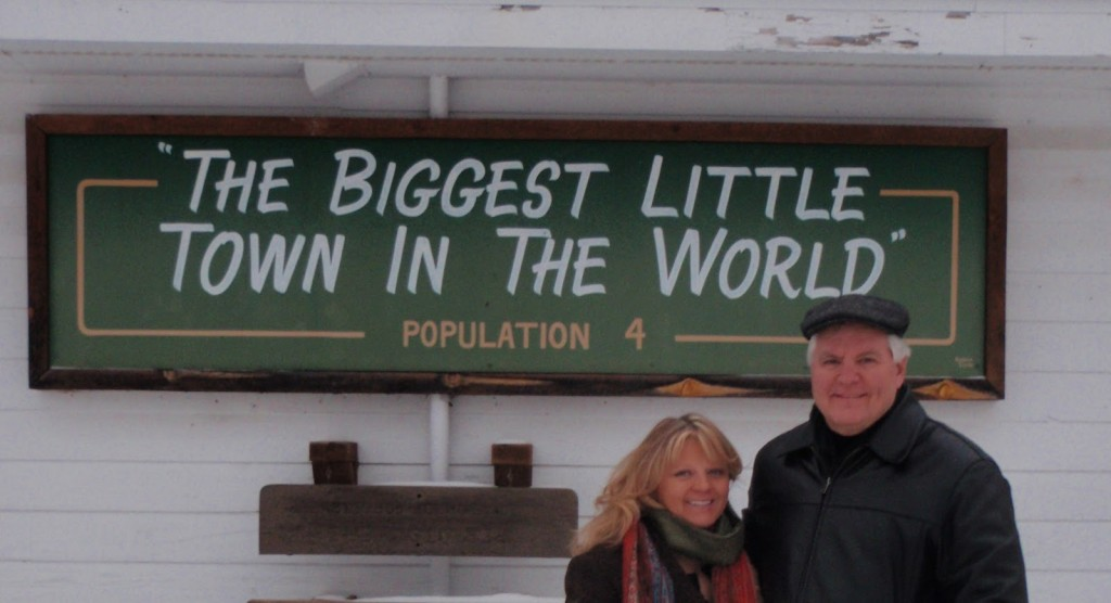 "Mike and Mel Spry, shown here, ""decided not to mess with a successful marketing tool"" created by a previous owner although the population today is only two. ""The Biggest Little Town in the World,"" advertising the population as four dates back to the 1980s. At that time the store's owner, his wife and two kids lived in Emmaville."