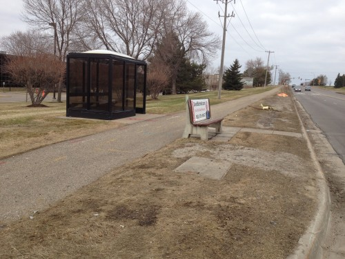 This may be a bus stop? Transit maps are agnostic on the issue. +1 for trash can in the shelter