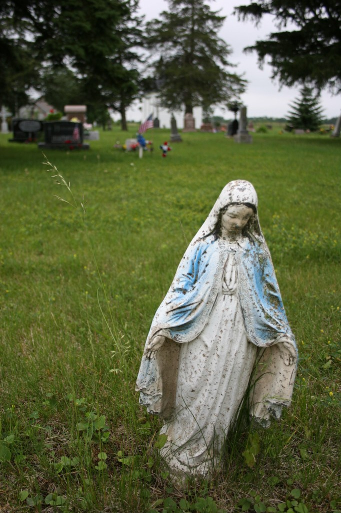 There's something compelling about this weathered statue of the Virgin Mary at Trebon Cemetery.