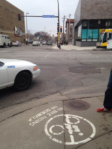 A cab turns right on red in a pedestrian heavy area where bikes are banned from the sidewalk (Hennepin and Lagoon, Minneapolis)
