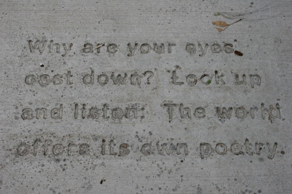 Word art (poetry) is imprinted upon sidewalks in downtown Northfield.