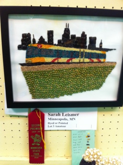 Seed art of light rail train against skyline