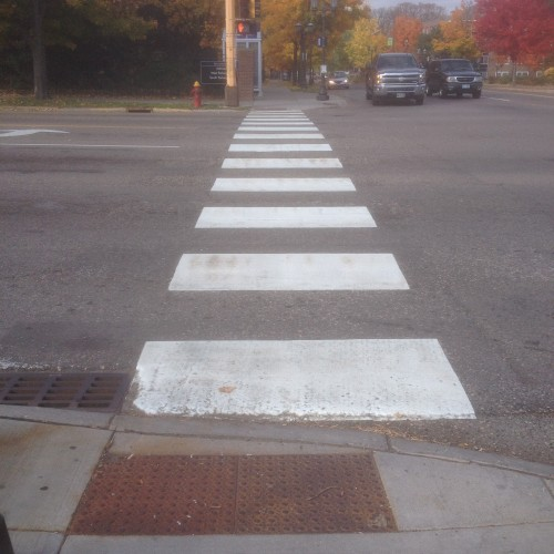 Good white zebra crosswalk markings and ped ramp