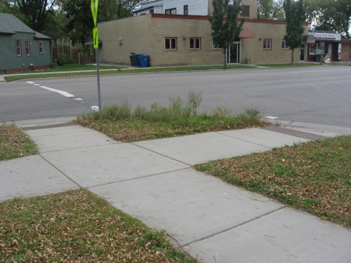 Street corner with sidewalks and ADA ramps at right angle