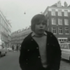 Image from the documentary from 1972. The streets are dominated by cars and there is not a tree in sight.