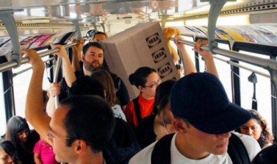 Crowded bus made more crowded by a poorly photoshopped ikea package.