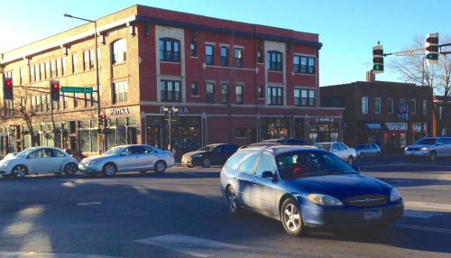 Cars turning the corner at Snelling and Selby