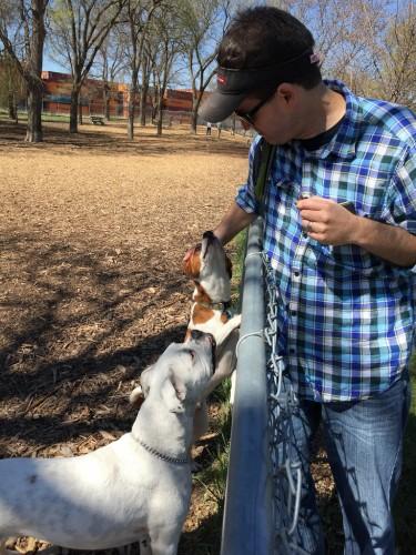 Scott petting two dogs