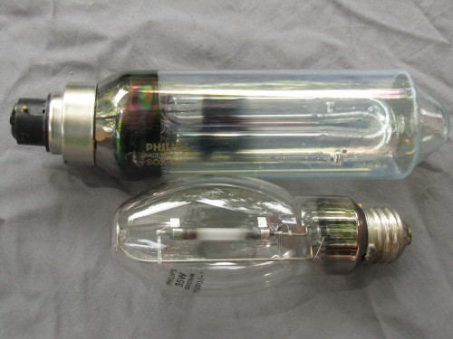 18 Watt Low pressure and 35 watt High Pressure Sodium Vapor lamps. These are smaller than are used for street lights, more typical for small wall mounted outdoor lights. They each produce about as much light as a 100 watt incandescent.