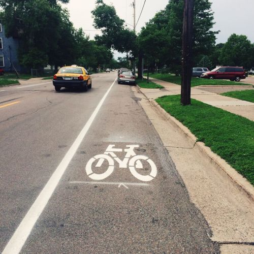 Cars parked in the bike lane.