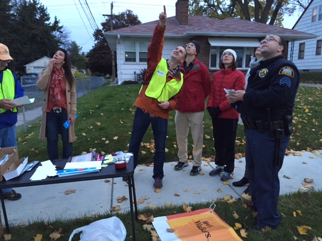 Kevin Gallatin points to missing streetlight which makes it difficult to see pedestrians stepping into the crosswalk
