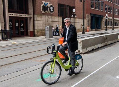 Michael Lewis enjoying an ice cream cone while on a Nice Ride Bike