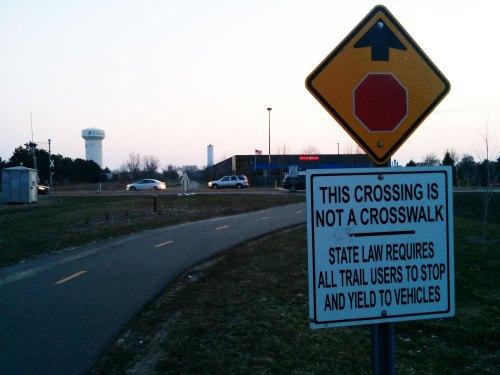 Crosswalk signage on Cedar Lake Trail