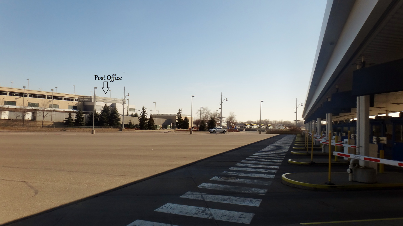 The promising crosswalk in front of the airport parking payment gates would lead to a (legal) dead-end.