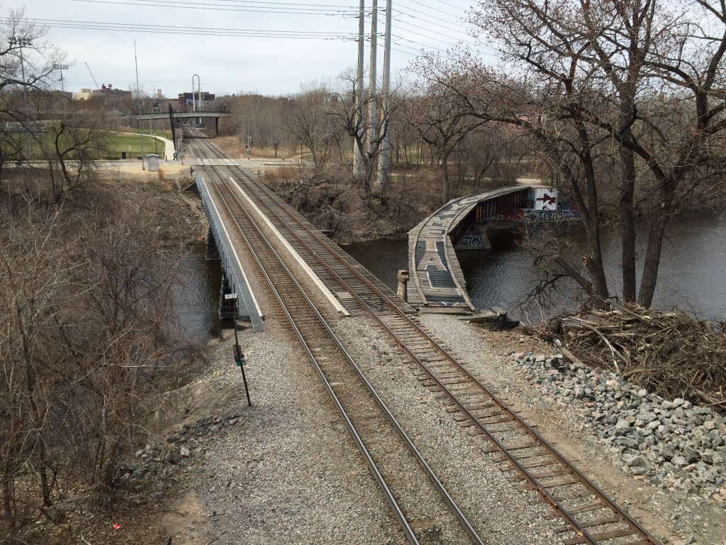 Heavy Metal spray painted on railroad tracks