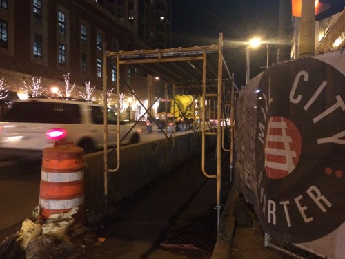 Temporary protected pedestrian accommodations adjacent to a construction site