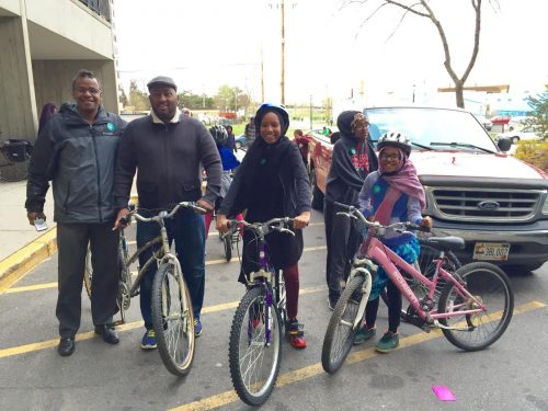 Students and volunteers preparing to bike to Seward Montessori School