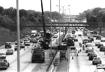 I-35W construction showing cone shaped NEMA lights in the background, early 1980s
