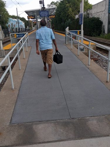A man enters the Cedar Riverside Station with no signage or staff present