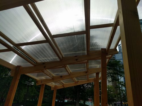 View looking up from inside shelters, with diffusers diffusing but not blocking light