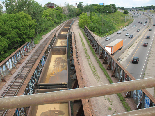 A view of the Greenway crossing of I-94 from the Pelham Blvd overpass, looking east.