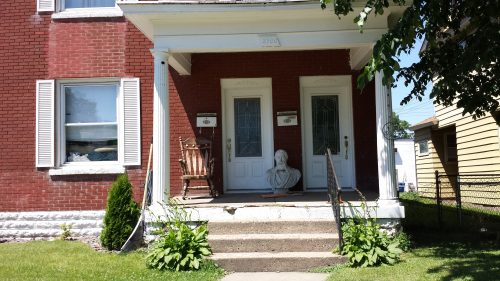 Front Porch with Rocker and Bust (2900 Tyler Street NE)