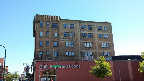 Bill's Imported Foods at W Lake St at Aldrich Ave S with the Calhoun Building in the Background