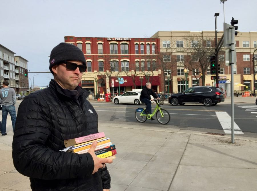 Scott returning home with a stack of books