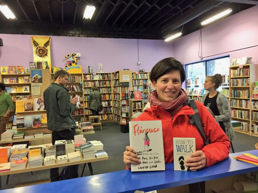 Janelle and the books purchased at Moon Palace Books - How to Walk by Thich Nhat Hanh and Flâneuse: Women Walk the City in Paris, New York, Tokyo, Venice and London by Lauren Elkin