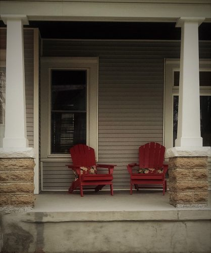 Front porch with two red chairs