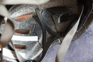 A bicycle helmet with multiple cracks after an accident