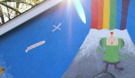 """Detail of a garage mural in South Minneapolis (an airplane flying a banner that says """"Corcoran Mpls."""")"""