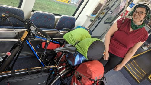 me with our two bikes in the fold-up seats ADA section of the train.