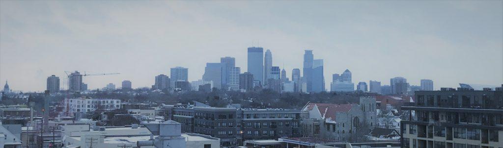 Minneapolis skyline with a clear winter sky.