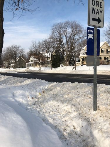 Photo of a bus stop made inaccessible by snow