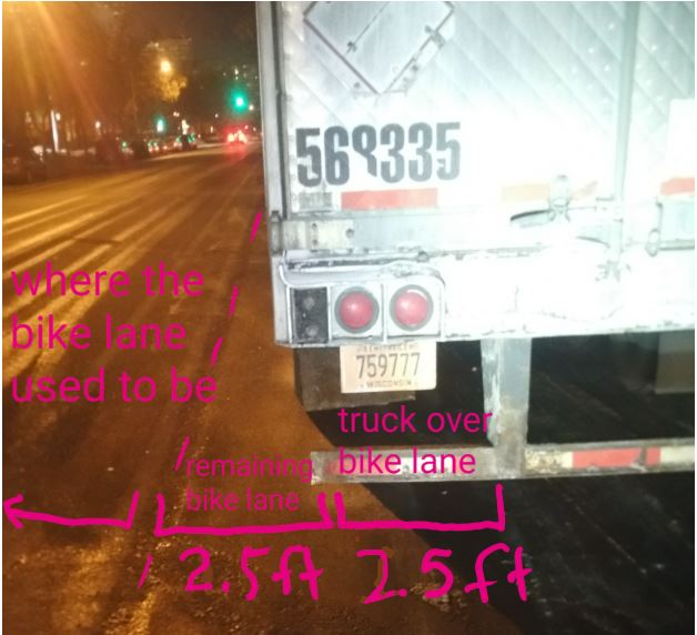 A truck is parked 2.5 feet into the current bike lane. The former bike lane would have been fine.