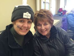 What's better than a curling rock toque? 2 smiling snowflake-painted faces!