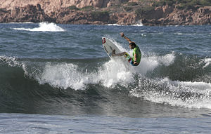 English: Italian surfer during a surf competit...