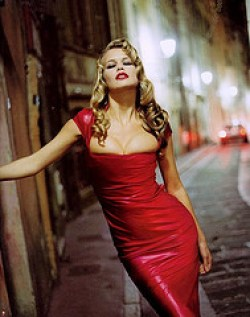 Claudia Schiffer wearing red latex dress