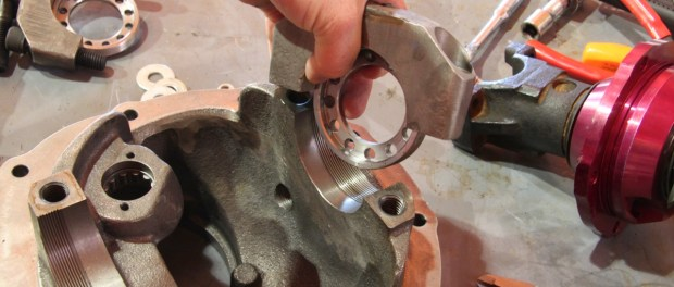 Each differential bearing cap has a threaded adjustment ring. The ring provides the side-to-side adjustment and the bearing preload for the locker.