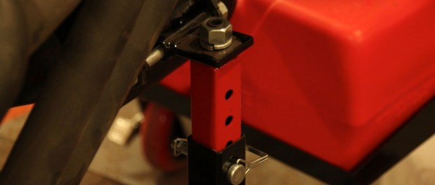 The motor mounts on the stand are adjustable and are secured with clevis pins.