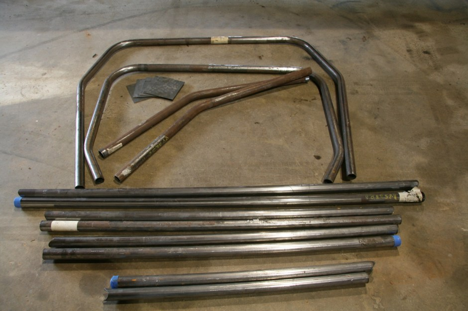 1. The roll cage shipped as three groups of bars wrapped with metal banding. It is important to lay all the bars out on a flat surface and check them for flatness. The roof and main hoop are very susceptible to twisting during shipping.