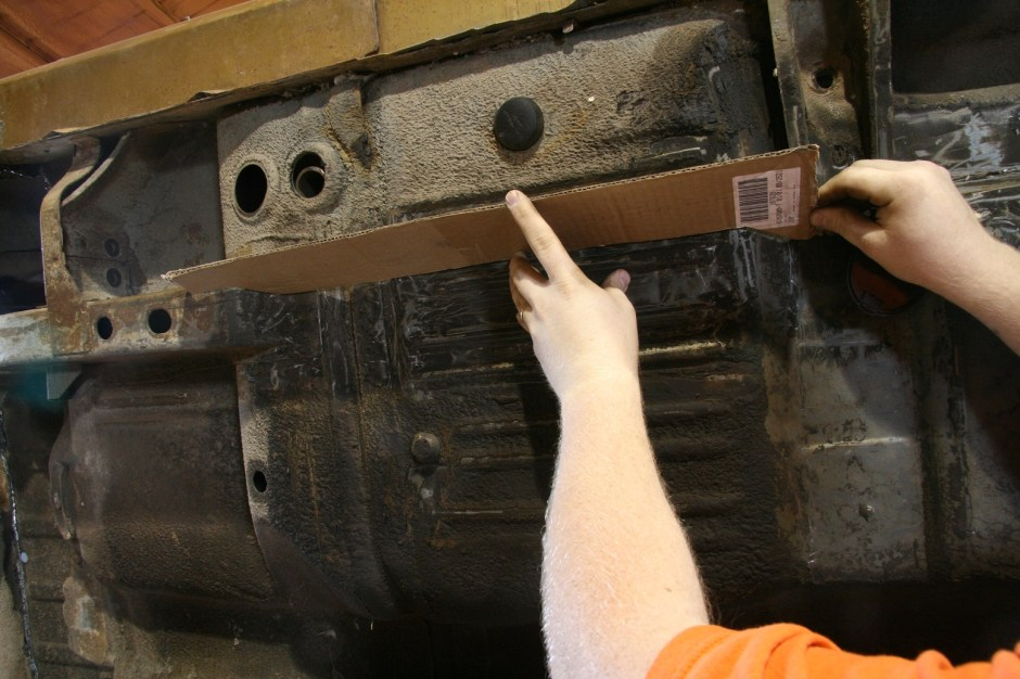 1. We started with the subframe connectors. Since we were building our own, a pattern was needed. Using cardboard, the line of the floor pan was traced and trimmed out. It is important for the connectors to follow the floor pan as close as possible.