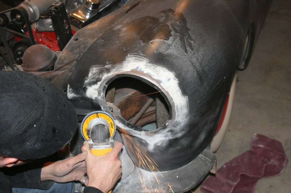 2. Our 51 Merc had already been hacked up to fit some Buick headlights, so we did not need to trim the opening. Had this car been stock, the hole would have been trimmed with a jigsaw. The area around the hole was cleared of all paint and body filler with a grinder to prep it for welding.